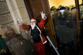 Santa Claus gets caught up in the riot. Students protest outside Parliament as MPs voted to increase tuition fees. London - Jess Hurd - 09-12-2010