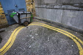 Street cleaner leaves a cart on double yellow lines a parking offence. East London. - Jess Hurd - 11-12-2010