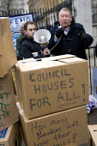 Austin Mitchell MP. Protest over housing benefit & rent reforms. Defend Council Housing. Downing Street, London. - Jess Hurd - 2010,2010s,activist,activists,against,austerity cuts,box,boxes,CAMPAIGN,campaigner,campaigners,CAMPAIGNING,CAMPAIGNS,cardboard box,Council,cuts,DEMONSTRATING,DEMONSTRATION,DEMONSTRATIONS,europeregi,ho