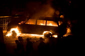 A burning car on a barricade. Uprising on the streets of Cairo against the dictatorship. Egypt. - Jess Hurd - 28-01-2011