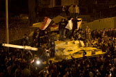 Protestors riding on tanks. Uprising on the streets of Cairo against the dictatorship. Egypt. - Jess Hurd - 28-01-2011