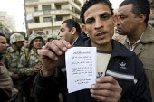 Protesters show a letter dropped by air from Mubarak. The day after The Day Of Rage, army and protesters. Al Tahrir Square, Cairo, Egypt. - Jess Hurd - 29-01-2011