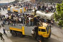 People ride on firefighter trucks. Uprising against President Mubarak, Cairo, Egypt. - Jess Hurd - 29-01-2011