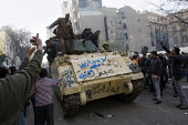 Protesters riding an amoured personnel carrier. Uprising against President Mubarak, Cairo, Egypt. - Jess Hurd - 29-01-2011