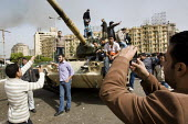 Youth taking pictures of each other on a tank. Uprising against Mubarak, Cairo, Egypt. - Jess Hurd - 2010,2010s,activist,activists,african,Africans,against,Al-Tahrir Square,Amateur Photographer,anti,arab,arabic,arabs,armed forces,armored,armoured,army,CAMERA,camera phone,cameras,CAMPAIGN,campaigner,c