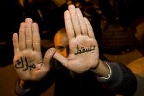 Down Mubarak written on the hands. Uprising against Mubark, Al-Tahrir (Liberation Square), Cairo, Egypt - Jess Hurd - 30-01-2011