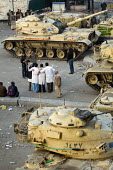 Doctors pose for pictures with army tanks. Medical volunteers treat people for head wounds from rocks in a makeshift field hospital outside the Cairo Museum, near Al-Tahrir (Liberation Square), Cairo,... - Jess Hurd - 2010s,2011,activist,activists,african,Africans,against,Amateur Photographer,anti-government protest,arab,arabic,arabs,armed forces,armored,armoured,army,CAMPAIGN,campaigner,campaigners,CAMPAIGNING,CAM