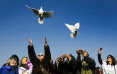 Releasing doves of peace. Annie Lennox, Bianca Jagger join women on Millennium Bridge and at bridges in more than 30 other countries on International Women Day centenary to demand that Afghan women si... - Jess Hurd - 08-03-2011