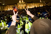 Police protect the Olympic clock in Trafalgar Square. - Jess Hurd - 2010s,2011,activist,activists,adult,adults,against,anti,Austerity Cuts,CAMPAIGN,campaigner,campaigners,CAMPAIGNING,CAMPAIGNS,CLJ,confront,confrontation,confronted,confronting,DEMONSTRATING,demonstrati