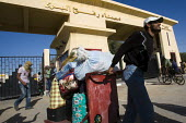 Bedouins make a living at the border carrying luggage for the small number of Palestinians that are allowed through the Rafah Crossing from Gaza. The border is controlled by the Egyptian army since Re... - Jess Hurd - 17-03-2011
