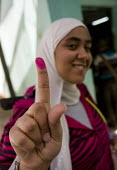 Egyptians vote in the referendum on the constitution. Cairo, Egypt Their fingers are stained with ink to indicate they have voted. - Jess Hurd - 2010s,2011,african,Africans,amending,amendment,amendments,arab,arabic,arabs,ballot,BALLOTING,ballots,change,changes,civil rights,constitution,constitutional,democracy,dress,egypt,Egyptian,Egyptians,FE