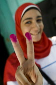 Egyptians vote in the referendum on the constitution. Cairo, Egypt Their fingers are stained with ink to indicate they have voted. - Jess Hurd - 19-03-2011