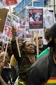 Supporters and family of the singer Smiley Culture have marched to Scotland Yard calling for a public inquiry into his death. The 80's reggae artist died from a stab wound while in police custody duri... - Jess Hurd - ,2010s,2011,activist,activists,adult,adults,anger,angry,artist,ARTISTS,BAME,BAMEs,Black,BME,bmes,CAMPAIGN,campaigner,campaigners,CAMPAIGNING,CAMPAIGNS,custody,David,DEATH,death in police custody,death