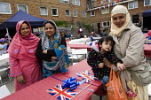 Royal wedding East End street party to celebrate the marriage of Prince William and Kate Middleton. Tower Hamlets, East London. - Jess Hurd - ,2010s,2011,asian,asians,BAME,BAMEs,Black,BME,BME Black Minority Ethnic,bmes,british,cities,city,council estate,council services,council estate,council services,diversity,ethnic,ethnicity,FEMALE,Flag,