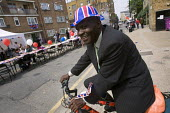 Royal wedding East End street party to celebrate the marriage of Prince William and Kate Middleton. Tower Hamlets, East London. - Jess Hurd - 2010s,2011,BAME,BAMEs,Black,BME,BME Black Minority Ethnic,bmes,british,cities,city,council estate,council services,council estate,council services,diversity,ethnic,ethnicity,Flag,flags,hat,hats,Housin
