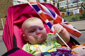 Royal wedding East End street party to celebrate the marriage of Prince William and Kate Middleton. Tower Hamlets, East London. - Jess Hurd - 2010s,2011,babies,baby,Child,CHILDHOOD,children,cities,city,EARLY YEARS,Flag,flags,infancy,infant,infants,juvenile,juveniles,kid,kids,LFL,LIFE,Lifestyle,marriage,Monarchy,nationalism,party,patriot,pat