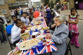 Royal wedding East End street party to celebrate the marriage of Prince William and Kate Middleton. Tower Hamlets, East London. - Jess Hurd - ,2010s,2011,adult,adults,age,ageing population,BAME,BAMEs,black,BME,BME Black Minority Ethnic,bmes,british,child,CHILDHOOD,children,cities,city,cultural,diversity,elderly,ethnic,ethnicity,female,femal