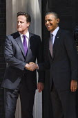 US President Barack Obama arrives at Number 10 Downing street to be greeted by Prime Minister David Cameron during a State visit. London. - Jess Hurd - ,2010s,2011,BAME,BAMEs,Black,BME,bmes,CONSERVATIVE,Conservative Party,conservatives,Democratic Party,Democrats,diversity,ethnic,ethnicity,Minister,minorities,minority,Obama,people,poc,POL Politics,Pre