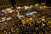 Fire engine passing through thousands of young people in Puerta del Sol in defiance of a government ban of protests. Protest against austerity cuts. They have renamed place Solution Square and are cal... - Jess Hurd - 21-05-2011