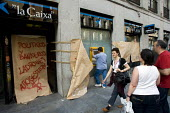 Banks are pasted with paper and slogans. Young people gather in Puerta del Sol in defiance of a government ban on protests against austerity cuts, they have renamed place Solution Square and are calli... - Jess Hurd - 21-05-2011