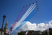 Red Arrows - the RAF aerobatic display team, perform a V formation flypast with red white and blue smoke trails for the Trooping of the Colour. Trafalgar Square. London. - Jess Hurd - 11-06-2011