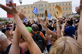 Protest outside the Greek parliament with Greek Flags, as the trade unions hold a general strike against austerity cuts. Syntagma Square, Athens, Greece. - Jess Hurd - 15-06-2011