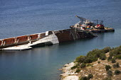 Capsized ship near port of Pireaus, Athens. Greece. - Jess Hurd - 17-06-2011
