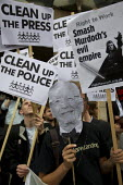 Demonstrators dress up as Rupert Murdoch outside the select committee enquiry into phone hacking. Portcullis House, Parliament, London. - Jess Hurd - 19-07-2011