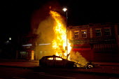 Police car on fire. Riots in Tottenham. Riot police clashed with hundreds of rioters after the fatal shooting of Mark Duggan, 29, who was killed by police on Thursday. North London. - Jess Hurd - 2010s,2011,adult,adults,arson,blaze,building,buildings,burn,burning,BURNS,cities,city,CLJ,conflict,conflicts,destroyed,destruction,fire,fires,flame,flames,MATURE,metropolitan police service,Police,POL
