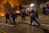 Riots in Tottenham. Riot police clashed with hundreds of rioters after the fatal shooting of Mark Duggan, 29, who was killed by police on Thursday. North London. - Jess Hurd - ,2010s,2011,adult,adults,arson,blaze,building,buildings,burn,burning,BURNS,cities,city,CLJ,conflict,conflicts,destroyed,destruction,fire,fires,flame,flames,force,MATURE,metropolitan police service,Off