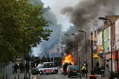 Riots spread to Hackney following the fatal police shooting of Mark Duggan, East London. - Jess Hurd - 2010s,2011,adult,adults,arson,AUTO,AUTOMOBILE,AUTOMOBILES,AUTOMOTIVE,BAME,BAMEs,Black,BME,bmes,burn,burning,BURNS,car,cars,cities,city,conflict,conflicts,destroyed,destruction,diversity,ethnic,ethnici