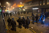 Riots in Tottenham. Riot police clashed with hundreds of rioters after the fatal shooting of Mark Duggan, 29, who was killed by police on Thursday. North London. - Jess Hurd - ,2010s,2011,adult,adults,arson,blaze,burn,burning,BURNS,cities,city,CLJ,conflict,conflicts,destroyed,destruction,fire,fires,flame,flames,force,MATURE,metropolitan police service,Officer,officers,polic