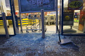 A smashed up Lidl as riots spread to Croydon following a fatal police shooting. Riot police struggle to maintain order as rioting spreads across the country after Mark Duggan, 29, was killed. East Lon... - Jess Hurd - 2010s,2011,adult,adults,conflicts conflict,Lidl,loot,looters,looting,MATURE,police,POLICING,rebellion,retail,RETAILER,RETAILERS,RETAILING,revolt,riot,rioting,riots,SERVICE,SERVICES,shop shops,smashed,