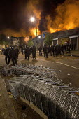 Riots in Tottenham. Riot police clashed with hundreds of rioters after the fatal shooting of Mark Duggan, 29, who was killed by police on Thursday. North London. - Jess Hurd - 2010s,2011,adult,adults,arson,blaze,burn,burning,BURNS,cities,city,CLJ,conflict,conflicts,destroyed,destruction,fire,fires,flame,flames,force,MATURE,metropolitan police service,Officer,officers,police
