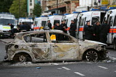 Burnt out police cars. Riots in Tottenham. Riot police clashed with hundreds of rioters after the fatal shooting of Mark Duggan, 29, who was killed by police on Thursday. North London. - Jess Hurd - 07-08-2011