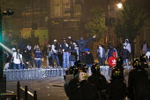 Riots in Tottenham. Riot police clashed with hundreds of rioters after the fatal shooting of Mark Duggan, 29, who was killed by police on Thursday. North London. - Jess Hurd - ,2010s,2011,adult,adults,BAME,BAMEs,black,BME,bmes,cities,city,CLJ,conflict,conflicts,cultural,diversity,ethnic,ethnicity,fire,fires,force,hooded,looting,mask,masked,masks,MATURE,metropolitan police s