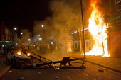 Riots in Tottenham. Riot police clashed with hundreds of rioters after the fatal shooting of Mark Duggan, 29, who was killed by police on Thursday. North London. - Jess Hurd - 2010s,2011,adult,adults,arson,BAME,BAMEs,Black,blaze,BME,bmes,building,buildings,burn,burning,BURNS,cities,city,CLJ,conflict,conflicts,destroyed,destruction,diversity,ethnic,ethnicity,fire,fires,flame