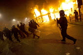 Riots in Tottenham. Riot police clashed with hundreds of rioters after the fatal shooting of Mark Duggan, 29, who was killed by police on Thursday. North London. - Jess Hurd - 2010s,2011,adult,adults,arson,blaze,building,buildings,burn,burning,BURNS,cities,city,CLJ,conflict,conflicts,destroyed,destruction,fire,fires,flame,flames,force,looting,MATURE,metropolitan police serv
