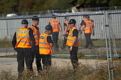 Bailiffs build an eviction site next to Dale Farm traveller site. Basildon Council. Essex. - Jess Hurd - 2010s,2011,bailiff,bailiffs,BAME,BAMEs,bigotry,BME,bmes,CLJ Crime Law & Justice ,DISCRIMINATION,diversity,equal,equality,ethnic,Ethnic Cleansing,ethnicity,eviction,Farm,gipsey,Gipsey Gipsy Gypsey,Gips