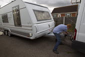 Travellers from Dale Farm move their caravans ahead the eviction by Basildon Council. Essex. - Jess Hurd - 2010s,2011,activist,activists,away,BAME,BAMEs,bigotry,BME,bmes,CAMPAIGN,campaigner,campaigners,CAMPAIGNING,CAMPAIGNS,caravan,caravans,CLJ Crime Law & Justice,DEMONSTRATING,demonstration,DEMONSTRATIONS