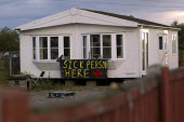 Sick person lives here. Travellers from Dale Farm on the eve of eviction by Basildon Council. Essex. - Jess Hurd - ,2010s,2011,activist,activists,BAME,BAMEs,bigotry,BME,bmes,CAMPAIGN,campaigner,campaigners,CAMPAIGNING,CAMPAIGNS,DEMONSTRATING,DEMONSTRATION,DEMONSTRATIONS,DISCRIMINATION,diversity,equal,EQUALITY,ethn