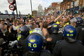 English Defence League attempt to march in Tower Hamlets is stopped by a state ban and the mobalisation of local people by Unite Against Fascism. Police march them over Tower Bridge to pubs in Bermond... - Jess Hurd - 03-09-2011