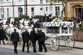 The funeral cortege of Mark Duggan who was killed by the police in Tottenham arrives at the New Testament Church of God, in Wood Green. North London. - Jess Hurd - 2010s,2011,adult,adults,BAME,BAMEs,Black,BME,BME Black Minority Ethnic,bmes,Church,churches,cities,city,CLJ,DEATH,death in police custody,deaths,died,diversity,ethnic,ethnicity,funeral,funerals,God,MA
