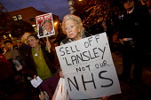 Doctors and student nurses protest in defence of the NHS outside Question Time with Andrew Lansley MP as guest. Queen Mary and Westfield College, East London. - Jess Hurd - 2010s,2011,activist,activists,against,anti,CAMPAIGN,campaigner,campaigners,CAMPAIGNING,CAMPAIGNS,College,COLLEGES,defence,defense,DEMONSTRATING,demonstration,DEMONSTRATIONS,FEMALE,national health serv