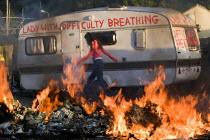 Dale Farm eviction, Basildon. London. - Jess Hurd - 2010s,2011,activist,activists,BAME,BAMEs,BME,bmes,burn,burning,BURNS,CAMPAIGN,campaigner,campaigners,CAMPAIGNING,CAMPAIGNS,caravan,caravans,DEMONSTRATING,DEMONSTRATION,DEMONSTRATIONS,diversity,EQUALIT