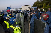 Riot police move in to remove travellers and their supporters from Dale Farm, Basildon. London. - Jess Hurd - 19-10-2011