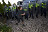Emotional scenes as riot police move in to remove travellers and their supporters from Dale Farm, Basildon. London. - Jess Hurd - 19-10-2011