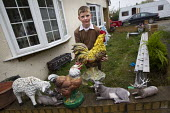 A young traveller helps his mother clean the garden ornaments on one of the legal plots left on Dale Farm. Constant & Co bailiffs and contractors bulldoze the plots at Dale Farm after Basildon Council... - Jess Hurd - 07-11-2011