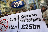 UK Uncut, the anti-austerity direct action group, demonstrates at high street stores of companies they say are tax dodging. Boots, Oxford Street. London. - Jess Hurd - 2010s,2011,activist,activists,against,avoidance,Boots,CAMPAIGN,campaigner,campaigners,CAMPAIGNING,CAMPAIGNS,civil disobedience,company,DEMONSTRATING,demonstration,DEMONSTRATIONS,evasion,Nonviolent Dir