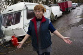 Maime Slattery tries to clear the comtaminated water from the septic tank broken by bailiffs. Dale Farm traveller site post eviction. Travellers report that the site and water supply is conaminated, a... - Jess Hurd - ,2010s,2011,BAME,BAMEs,bigotry,BME,bmes,broken,caravan,caravans,CHILD,CHILDHOOD,children,claim,closed,closing,closure,closures,council,derelict,DERELICTION,deserted,DISCRIMINATION,disused,diversity,em